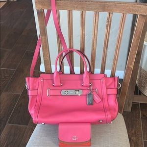 Beautiful pink coach purse and wallet